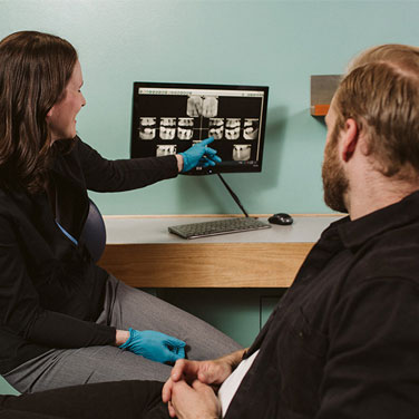 Dr.CORINNE reviews x-ray with patient